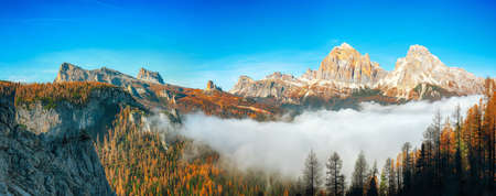 Autumn sunny landscape with View of Tofana di Rozes and Cinque Torri. Location: Cortina d'Ampezzo, Province of Belluno, South Tyrol, Italy, Europe
