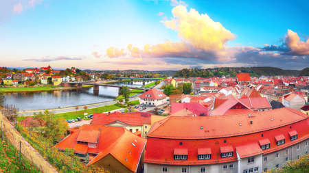 Fantastic sunset view on cityscape of Meissen town on the River Elbe. Location: Meissen, Saxony, Germany, Europe. Banco de Imagens