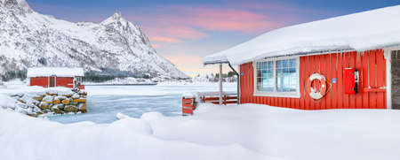 Stunning winter scenery with traditional Norwegian red wooden houses on the shore of Rolvsfjord on Vestvagoy island at Lofotens. Location: Vestvagoy, Rolvsfjord, Lofotens, Norway, Europe.