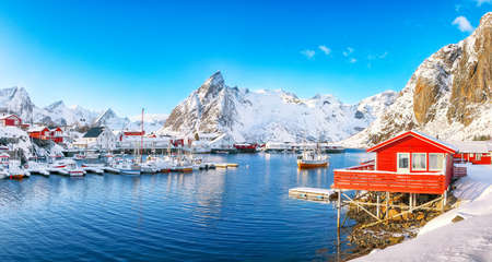 Fantastic winter view on Hamnoy village with port and Olstinden peak on background. Location: Hamnoy, Moskenesoya, Lofoten; Norway, Europe