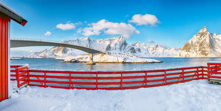 Fantastic winter view on Hamnoy village and bridge to Olenilsoya island. Popular tourist destination on Lofotens. Location: Hamnoy, Moskenesoya, Lofoten; Norway, Europe