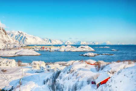 Fabulous winter view of Hamnoy fishing village and bridge seen from Olenilsoya island. Location: Olenilsoya island, Lofoten; Norway, Europe