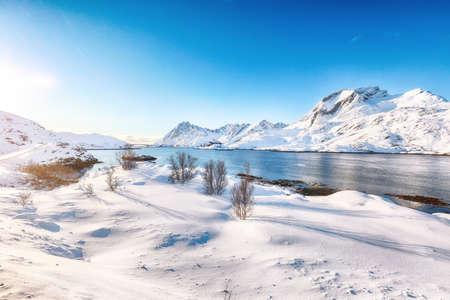 Outstanding winter view on Sundstraumen strait that separates Moskenesoya and Flakstadoya islands. Location: Flakstadoya island Lofoten; Norway, Europe