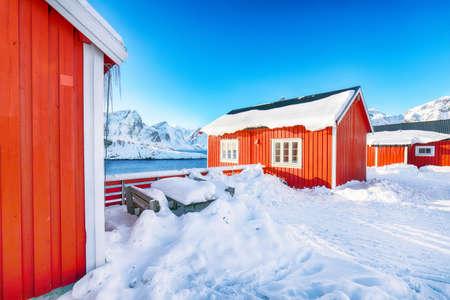 Traditional Norwegian red wooden houses on the shore of Reinefjorden in Hamnoy village. Location: Hamnoy, Lofoten; Norway, Europe