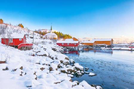 Amazing winter scenery of Moskenes village with ferryport and famous Moskenes parish Church. Popular travel destination on Lofotens. Location: Sorvagen, Moskenes, Lofoten; Norway, Europe