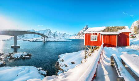 Charming winter view on Hamnoy village and bridge to Olenilsoya island. Popular tourist destination on Lofotens. Location: Hamnoy, Moskenesoya, Lofoten; Norway, Europe