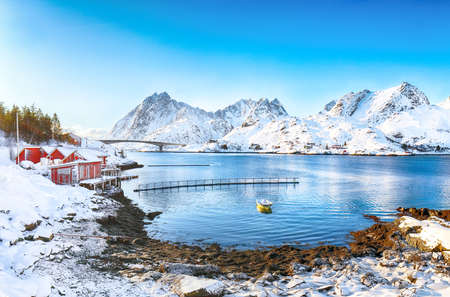 Winter view of small fishing village on Sundstraumen strait and Kakern Bridge that separates Moskenesoya and Flakstadoya islands. Location: Flakstadoya island, Lofoten; Norway, Europe
