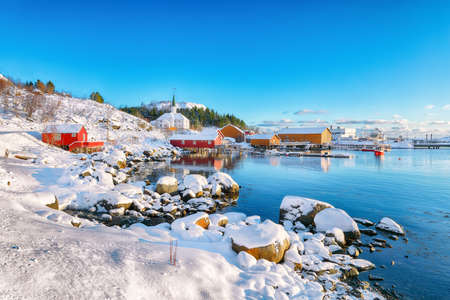 Awesome winter scenery of Moskenes village with ferryport and famous Moskenes parish Church. Popular travel destination on Lofotens. Location: Sorvagen, Moskenes, Lofoten; Norway, Europe