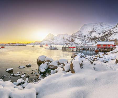 Stunning winter scenery of Moskenes village with ferryport. Popular travel destination on Lofotens. Location: Sorvagen, Moskenes, Lofoten; Norway, Europe