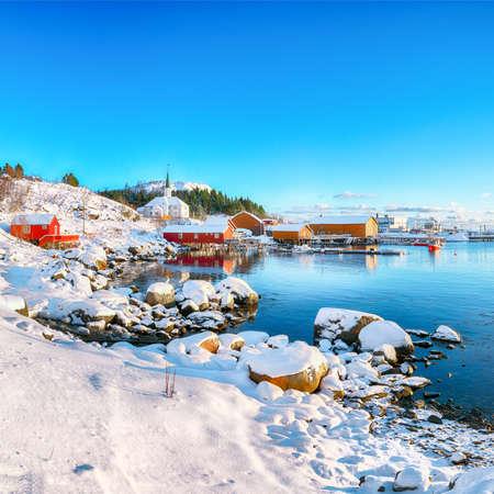 Stunning winter scenery of Moskenes village with ferryport and famous Moskenes parish Church. Popular travel destination on Lofotens. Location: Sorvagen, Moskenes, Lofoten; Norway, Europe