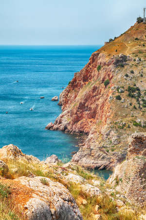 Views of the surrounding countryside near the Balaklava bay in Sevastopol city. Rocky cliffs above the beautiful clear sea. Crimea
