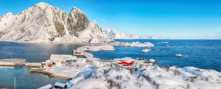 Fabulous winter view of Hamnoy fishing village and bridge seen from Olenilsoya island with Festheltinden peak in background. Location: Olenilsoya island, Lofoten; Norway, Europe