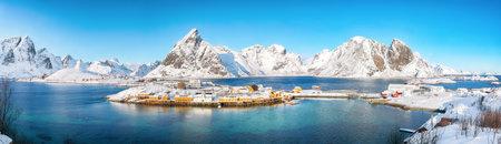 Astonishing winter view of Sakrisoy village and snowy mountaines on background. Popular tourist destination on Lofotens. Location: Sakrisoy, Moskenesoya, Lofoten; Norway, Europe