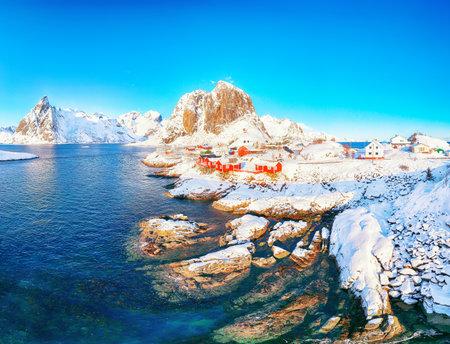 Outstanding winter view on Hamnoy village and Festhaeltinden mountain on background. Popular tourist destination on Lofotens. Location: Hamnoy, Moskenesoya, Lofoten; Norway, Europe