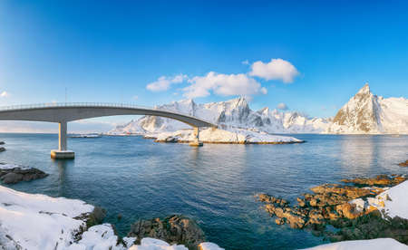 Panoramic winter view on Hamnoy village and bridge to Olenilsoya island. Popular tourist destination on Lofotens. Location: Hamnoy, Moskenesoya, Lofoten; Norway, Europe