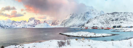 Picturesque morning view of Torsfjorden fjord with Fredvang village and snowy mountain peaks at backgroud. Location: Fredvang, Flakstadoya island, Lofoten; Norway, Europe