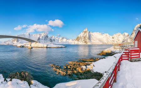 Fabulous winter view on Hamnoy village and bridge to Olenilsoya island. Popular tourist destination on Lofotens. Location: Hamnoy, Moskenesoya, Lofoten; Norway, Europe
