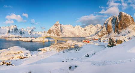 Stunning winter view on Reine, Sakrisoya and Hamnoy villages and bridge to Olenilsoya island. Location: Hamnoy, Moskenesoya, Lofoten; Norway, Europe