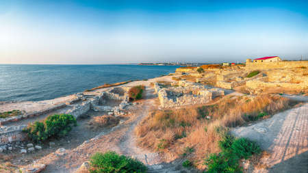 Awesome sunset over ruins of ancient city Tauric Chersonese - national historical and archaeological reserve. Sevastopol. Crimea Imagens