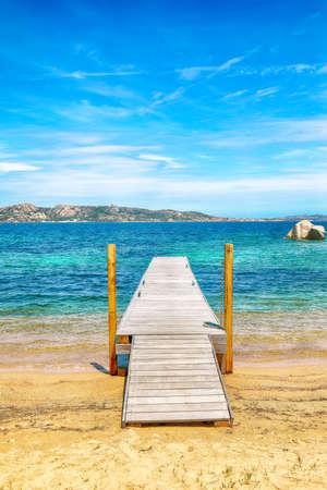 Astonishing view of wooden pier on public beach in Porto Rafael resort. Location: Porto Rafael, Olbia Tempio province, Sardinia, Italy, Europe