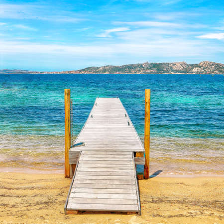 Awesome view of wooden pier on public beach in Porto Rafael resort. Location: Porto Rafael, Olbia Tempio province, Sardinia, Italy, Europe