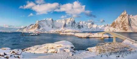 Panoramic winter view on Reine and Sakrisoya villages and bridge to Olenilsoya island. Popular tourist destination on Lofotens. Location: Hamnoy, Moskenesoya, Lofoten; Norway, Europe