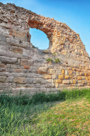 Awesome sunset over ruins of ancient city Tauric Chersonese - national historical and archaeological reserve. Sevastopol. Crimea 免版税图像