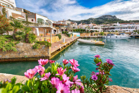 Awesome view of Poltu Quatu port and bay with yachts and motorboats on Costa Smeralda. Popular travel destination of Mediterranean sea. Location: Poltu Quatu, Province of Sassari, Sardinia, Italy, Europe 免版税图像