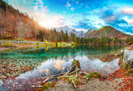 Breathtaking view of sunset over Fusine lake with Mangart peak on background. Popular travel destination of Julian Alps. Location: Tarvisio comune, Province of Udine, Italy, Europe