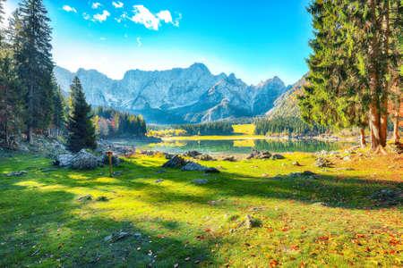 Astonishing view of Fusine lake with Mangart peak on background. Popular travel destination of Julian Alps. Location: Tarvisio comune, Province of Udine, Italy, Europe