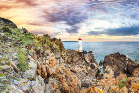 Fabulous view of sunset over Capo Ferro Lighthouse. Popular travel destination of Mediterranean sea. Location: Porto Cervo, Province of Sassari, Sardinia, Italy, Europe
