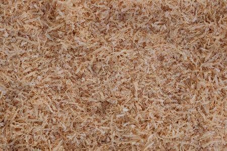 Warme achtergrond structuur patroon van naald hout spaanders.