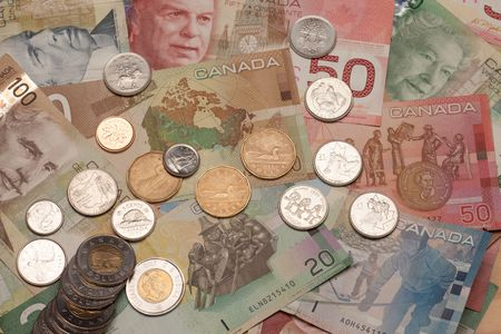 canadian cash: Background of Canadian money: 5,10,20,50,100 dollar bills and coins, loonie, toonie, quarter, dime, nickel, penny