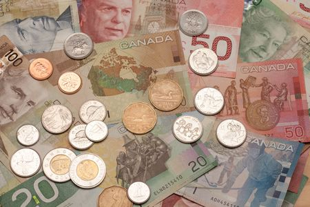 monies: Background of Canadian money: 5,10,20,50,100 dollar bills and coins, loonie, toonie, quarter, dime, nickel, penny