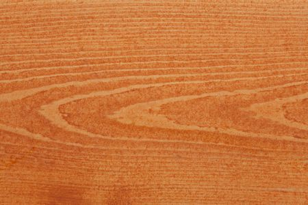 Pine or spruce (softwood) deck board stained with cedar colored transparent deck stain. photo