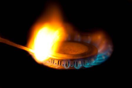 Blue flames of propane burner ignite match photo