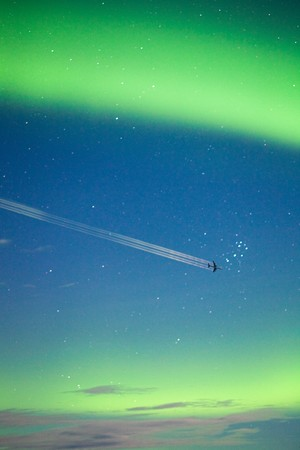 ionosphere: Airplane on moon lit night sky with intense Aurora borealis display and lots of stars. Stock Photo