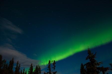 Aurora borealis and lots of stars around the constellation Big Dipper. photo