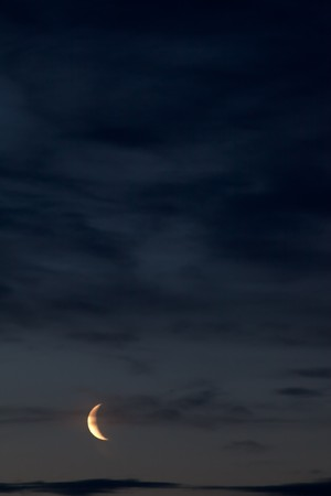 Night sky with moon and some clouds