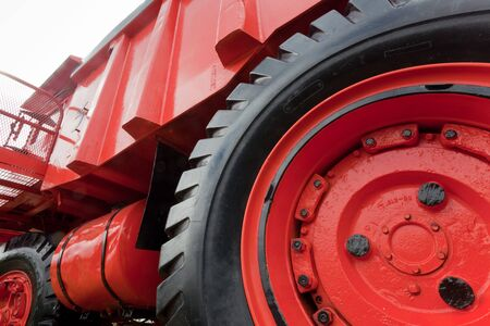 Enormous wheel, rim and tire, of vinatge giant mining truck photo