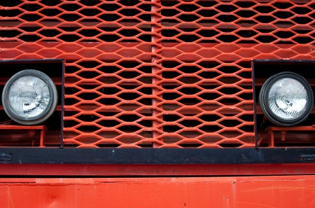 mining truck: Head beam lamps and grill of vinatge giant mining truck.