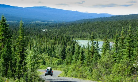 Travelling the North Canol Road, Yukon Territory, Canada, with canoe on roofrack. Stock Photo