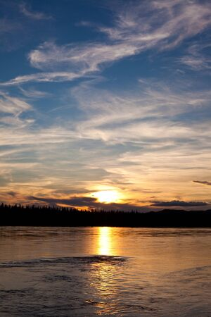boreal: Sunset over boreal forest at Yukon River, Canada Stock Photo