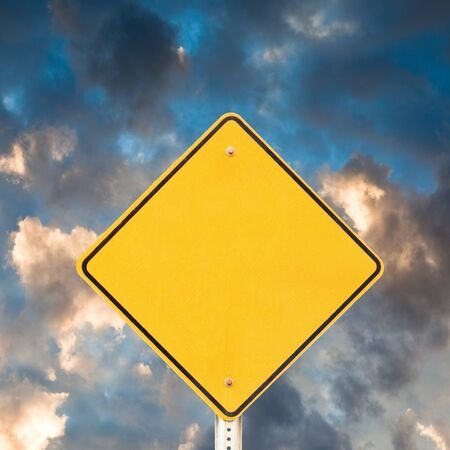 sky  dramatic: Blank yellow warning road sign with dramatic sky background ready to carry your message. Stock Photo
