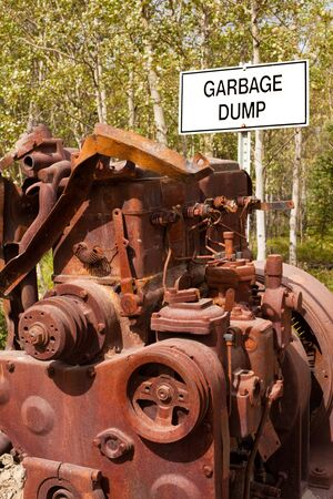 rusty car: Big rusty diesel engine block in front of sign posting  Stock Photo