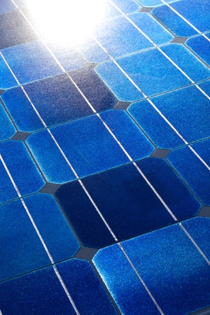 Pattern of solar cell wafers in photovoltaic solar panel with sun glare. photo