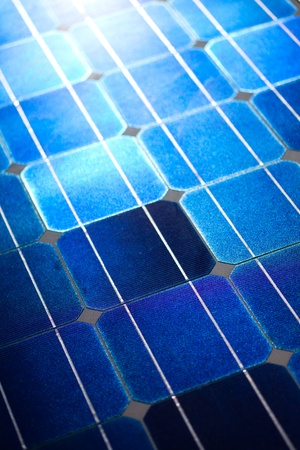 photoelectric: Pattern of solar cell wafers in photovoltaic solar panel with sun glare.