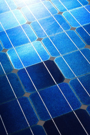 photons: Pattern of solar cell wafers in photovoltaic solar panel with sun glare.