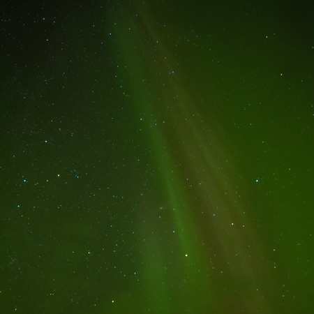 Clear night sky with lots of stars and faint northern lights (Aurora borealis) display. Stock Photo