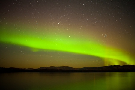 polaris: Intense northern lights (Aurora borealis) over Lake Laberge, Yukon Territory, Canada.